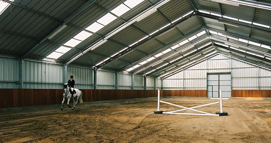Horse Arena interior obstacle course light steel building